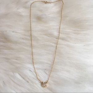 Minimal gold tone necklace with CZ pendant